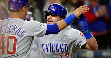 Chicago Cubs' Kyle Schwarber (12) is congratulated by Willson Contreras after Schwarber's two-run home run against the Seattle Mariners during the eighth inning of a baseball game Tuesday, April 30, 2019, in Seattle.