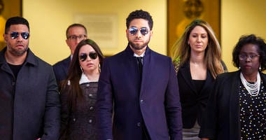 Actor Jussie Smollett, center, leaves the Leighton Criminal Courthouse in Chicago after prosecutors dropped all charges against him on Tuesday, March 26, 2019