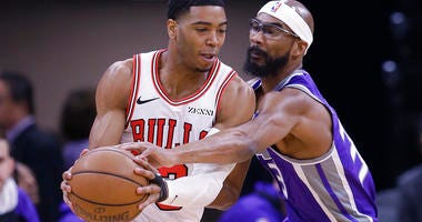 Sacramento Kings guard Corey Brewer, right, tries to steal the ball from Chicago Bulls guard Shaquille Harrison during the first half of an NBA basketball game Sunday, March 17, 2019, in Sacramento, Calif.