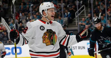 Chicago Blackhawks left wing Alex DeBrincat celebrates after scoring against the San Jose Sharks during the second period of an NHL hockey game in San Jose, Calif., Thursday, March 28, 2019.