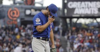 Chicago Cubs pitcher Yu Darvish reacts as he walks toward the dugout after the end of the fourth inning of a baseball game against the San Francisco Giants in San Francisco, Tuesday, July 23, 2019.