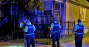 Police investigate a shooting about 10:30 p.m. Saturday, July 21, 2018 in the 200 block of West 106th St in Chicago.