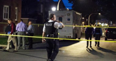 """Chicago Police investigate in the 5200 block of West Ohio, where an officer shot a man during an """"armed encounter"""" early Saturday, May 26, 2018. 