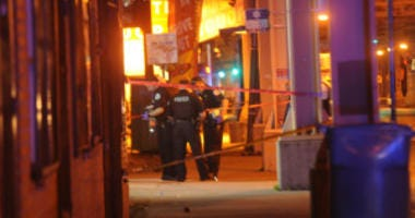 Police investigate a shooting about 11:30 p.m. Friday, June 15, 2018 in the 400 block of East 63rd Street in Chicago.