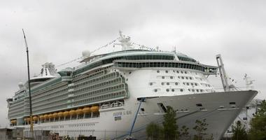 This May 11, 2006 file photo shows the Freedom of the Seas cruise ship docked in Bayonne, N.J. Police in Puerto Rico say that on Sunday, July 7, 2019, a toddler apparently slipped from her grandfather's hands and fell to her death on this cruise ship