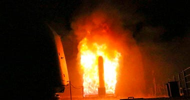 In this image provided by the U.S. Navy, the guided-missile cruiser USS Monterey (CG 61) fires a Tomahawk land attack missile early Saturday, April 14, 2018, as part of the military response to Syria's use of chemical weapons on April 7. The United States