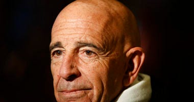 Tom Barrack, chairman of the inaugural committee, speaks with reporters in the lobby of Trump Tower in New York. The Associated Press has learned that investigators working with special counsel Robert Mueller have interviewed Barrack.