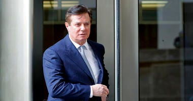 In this Feb. 14, 2018, file photo, Paul Manafort, President Donald Trump's former campaign chairman, leaves the federal courthouse in Washington. Special counsel Robert Mueller has turned up the heat on Manafort, threatening new criminal charges for witn