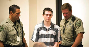 Suspected Dixon High School shooter Mathew Milby is escorted into Lee County court Thursday, June 7, 2018, for a hearing on his case in Dixon, Ill.