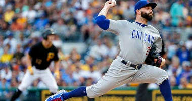 Chicago Cubs starter Tyler Chatwood, right, pitches as Pittsburgh Pirates' Corey Dickerson, left, leads off first during the first inning of a baseball game Saturday, Aug. 18, 2018, in Pittsburgh. (AP Photo/Keith Srakocic)