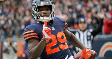 Chicago Bears running back Tarik Cohen (29) celebrates after running to the end zone for a touchdown during the first half of an NFL football game against the New York Jets Sunday, Oct. 28, 2018, in Chicago. (AP Photo/Nam Y. Huh)