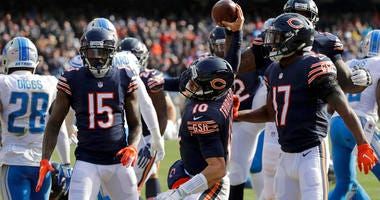 Chicago Bears quarterback Mitchell Trubisky (10) spikes the ball after rushing for a touchdown during the first half of an NFL football game against the Detroit Lions Sunday, Nov. 11, 2018, in Chicago. (AP Photo/Nam Y. Huh)