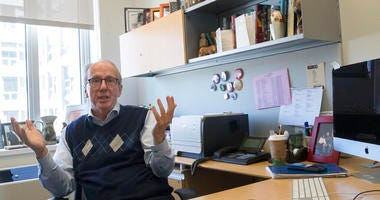 In this Tuesday, April 16, 2019, photo Steve Burghardt, a professor of social work at the City University of New York, gestures as he speaks in his office at Hunter College's Silberman School of Social Work.