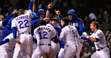Chicago Cubs players celebrate after Kris Bryant hit a walk-off, three-run home run during the ninth inning of a baseball game to defeat the Miami Marlins 5-2, Tuesday, May 7, 2019, in Chicago.