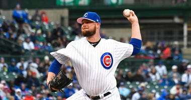 Chicago Cubs starting pitcher Jon Lester (34) throws the ball against the Milwaukee Brewers during the first inning of a baseball game, Sunday, May, 12, 2019, in Chicago.