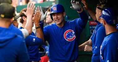 Chicago Cubs' Anthony Rizzo celebrates his home run in the dugout during the third inning of a baseball game against the Washington Nationals, Sunday, May 19, 2019, in Washington.