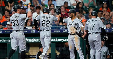 Chicago White Sox's Charlie Tilson (22) celebrates with Leury Garcia (28) and James McCann (33) after hitting a grand slam against the Houston Astros during the sixth inning of a baseball game Wednesday, May 22, 2019, in Houston.