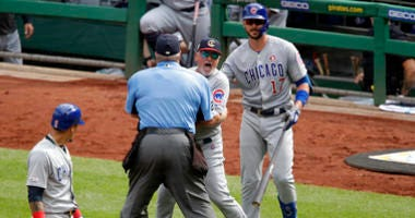 Chicago Cubs manager Joe Maddon, center, yells toward the Pittsburgh Pirates dugout as he is restrained by umpire Joe West and Cubs' Kris Bryant (17) during the fourth inning of a baseball game in Pittsburgh, Thursday, July 4, 2019. Maddon was ejected.