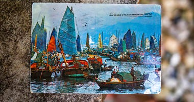 Kim Draper received a postcard, which depicts a scene of fishing boats in Hong Kong, at her home in Springfield on July 8, 2019 that was postmarked and sent from Hong Kong exactly 26 years ago on July 8, 1993