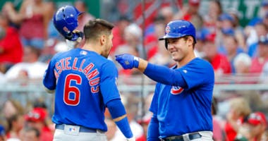 Chicago Cubs' Nicholas Castellanos (6) celebrates with Anthony Rizzo, right, after hitting a solo home run off Cincinnati Reds starting pitcher Alex Wood during the third inning of a baseball game Thursday, Aug. 8, 2019, in Cincinnati.