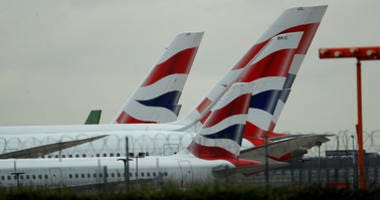 British Airways planes sit parked at Heathrow Airport in London, Monday, Sept. 9, 2019. British Airways says it has had to cancel almost all flights as a result of a pilots' 48-hour strike over pay.