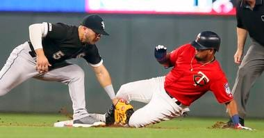 Minnesota Twins' Luis Arraez, right, beats the tag by Chicago White Sox second baseman Yolmer Sanchez to double in the third inning of a baseball game Tuesday, Sept. 17, 2019, in Minneapolis.