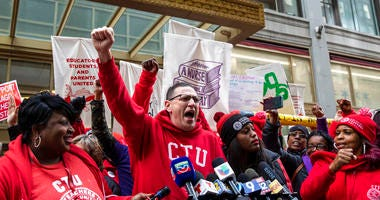 Chicago Teachers Union President Jesse Sharkey speaks during a rally outside Chicago Public Schools headquarters in the Loop, before marching through downtown with thousands of striking union members and their supporters, Thursday, Oct. 17, 2019