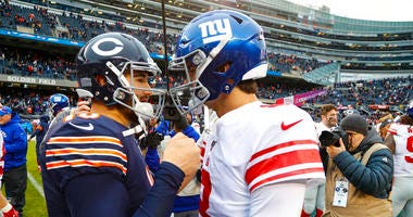 Chicago Bears quarterback Mitchell Trubisky (10) greets New York Giants quarterback Daniel Jones (8) following an NFL football game in Chicago, Sunday, Nov. 24, 2019. The Bears defeated the Giants 19-14.