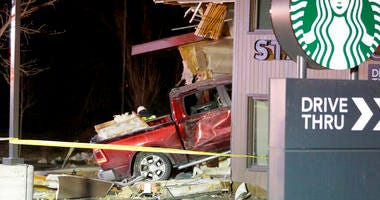 Personnel work at the scene in McHenry, Ill. where a vehicle drove into the Starbucks Thursday, Jan. 16, 2020.