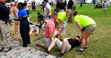 Spectators are tended to after a lightning strike on the course left several injured during a weather delay in the third round of the Tour Championship golf tournament Saturday, Aug. 24, 2019, in Atlanta.