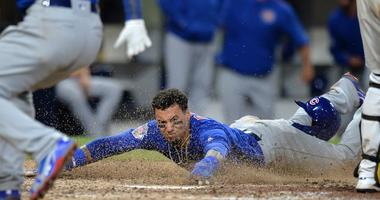 Jul 13, 2018; San Diego, CA, USA; Chicago Cubs second baseman Javier Baez (9) slides in safely to score on a throwing error by San Diego Padres catcher Austin Hedges (not pictured) during the tenth inning at Petco Park. Mandatory Credit: Jake Roth-USA TOD