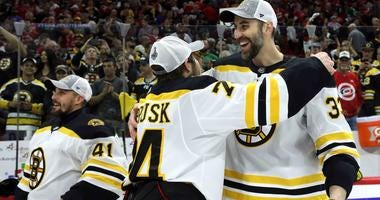 Zdeno Chara and Tuukka Rask of the Boston Bruins celebrate after advancing to the 2019 Stanley Cup Final.