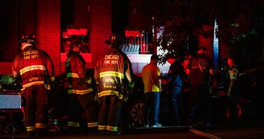Chicago fire fighters respond to an apartment fire, Monday night, in the 3100 block of North California, in the Avondale neighborhood.