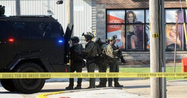 Police in heavy gear could be seen outside a residential home Monday in Calumet City.