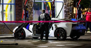 Police investigate a shooting at a vacuum stall of the Fuller's Express $3 Car Wash at 2146 S. Rockwell St.