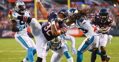 Bears running back David Montgomery (32) runs for a touchdown against the Panthers.
