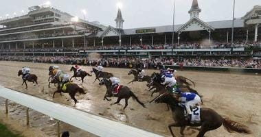 Horses race down the muddy track at Churchill Downs during the 2018 Kentucky Derby.