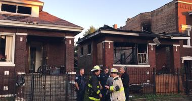 Firefighters struck out a fire that spread to three buildings Friday in Chicago Lawn on the South Side.