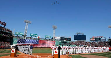 The Boston Red Sox line up during their home opener at Fenway Park in 2018.