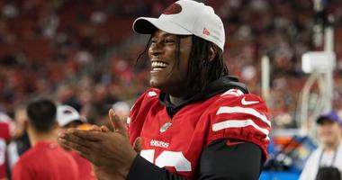 Reuben Foster claps on the San Francisco 49ers sideline.