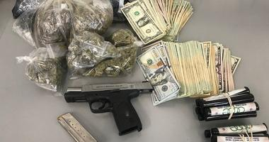 Police seized drugs, guns and cash in a series of drug raids on the South Side ahead of Memorial Day weekend.