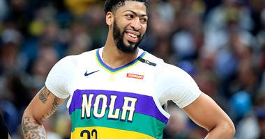Anthony Davis smiles during a game with the New Orleans Pelicans.