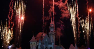 A fireworks display is seen during the holiday lighting ceremony at Disneyland on November 25, 2003 in Anaheim, California.