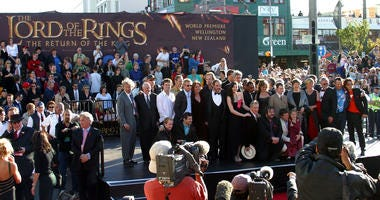"Lord of the Rings stars and crew gather with New Zealand Prime Minister Helen Clark (5th-R, grey shawl) and Mayor of Wellington City Kerry Prendergast (4th-R, red shawl) during the world premiere of the film, ""Lord of the Rings - Return of the King"""