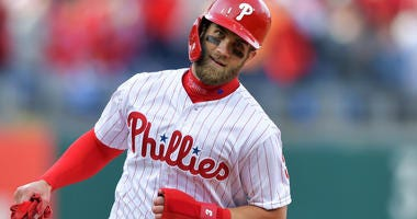Bryce Harper rounds the bases after hitting a home run for the Philadelphia Phillies