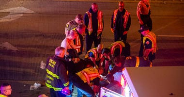 Chicago fire fighters operate on a person who was injured in a vehicle crash, Friday morning, in the out-bound local lanes of I-90 near 65th Street.