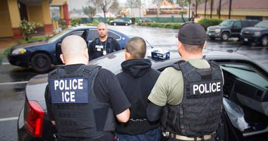 In this Feb. 7, 2017, file photo released by U.S. Immigration and Customs Enforcement, foreign nationals are arrested during a targeted enforcement operation conducted by U.S. Immigration and Customs Enforcement (ICE) fugitives.