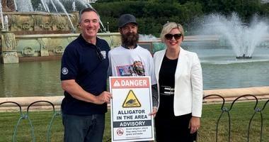 Frank Robb, alligator wrangler, turns on Buckingham Fountain