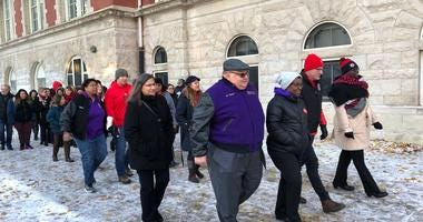 Chicago Teachers Union President Jesse Sharkey joined SEIU Local 73 PresidentDianPalmer as they walked together, along with others including some parents, into Yates Elemtary School.