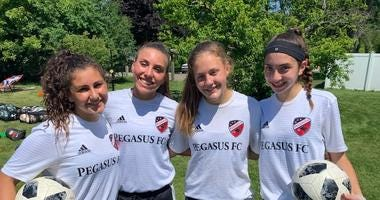 Four young women from the Chicago suburbs are heading to the World Cup of Youth Soccer.